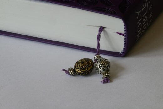 Inserted Bookmark with a gold and black turtle pendant